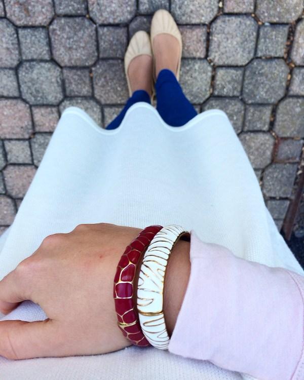 White sweeter with denim leggings