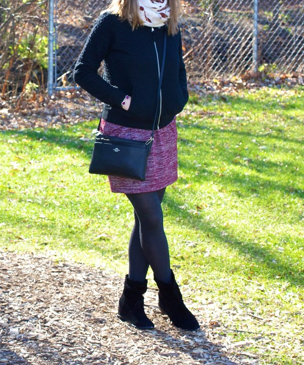 Black bomber jacket and ruby dress