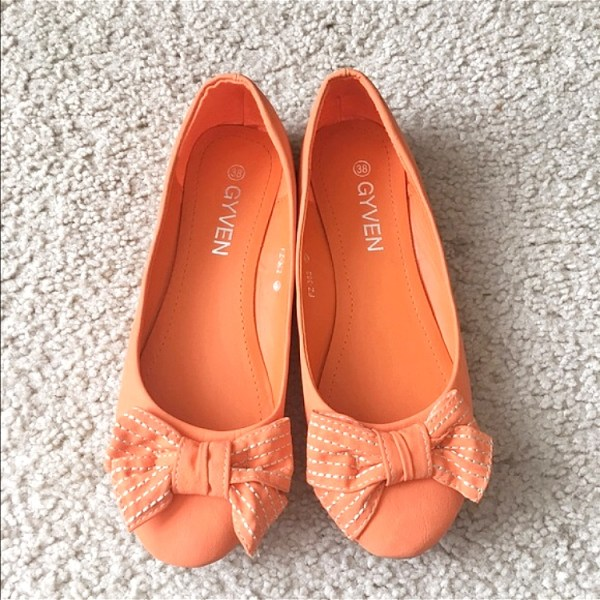 Orange flats with a bow