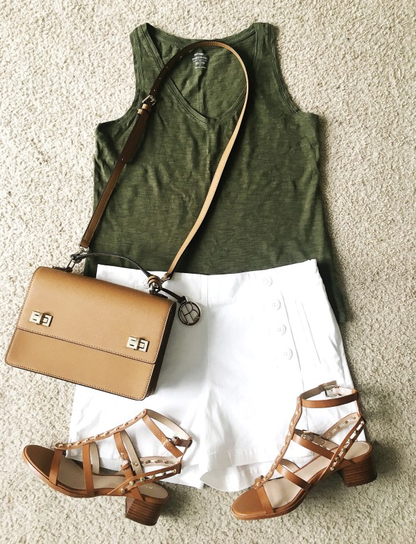 white shorts and green top summer outfit idea