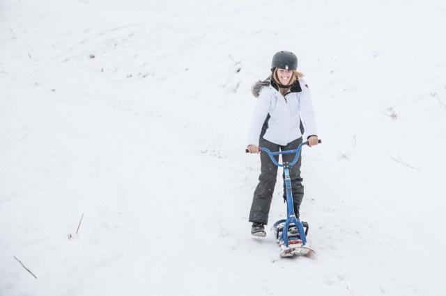 Glamping Blog News 8 Winter Activities Snow Scooting - Kristen Kellogg