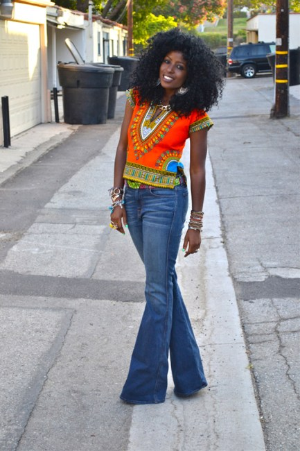 Folake Huntoon in dashiki shirt and boot-cut jeans