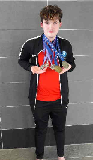 Aaron with swimming medals