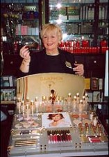 Photo: Mary Bell at beauty counter.