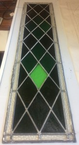 Previous repairs have not put much attention in maintaining the original characteristics of the windows: here you can see a clear colour miss-match for one of the diamond shaped glass from a panel in the church's tower.