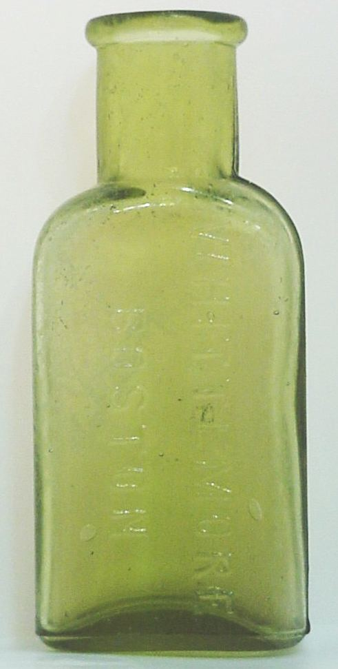 Whittemore Shoe Polish bottle in Citron colored glass