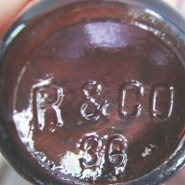 "R & CO bottle with straight-line marking. (Photo courtesy of ""Vintage Trekker"" on Etsy & Facebook)"