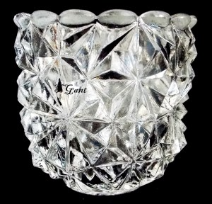 """Clear glass toothpick (or candleholder) marked """"FAROY / PATENT PENDING / U.S.A."""". Uncertain pattern name (if it has one). Photo courtesy of Terri Gant."""