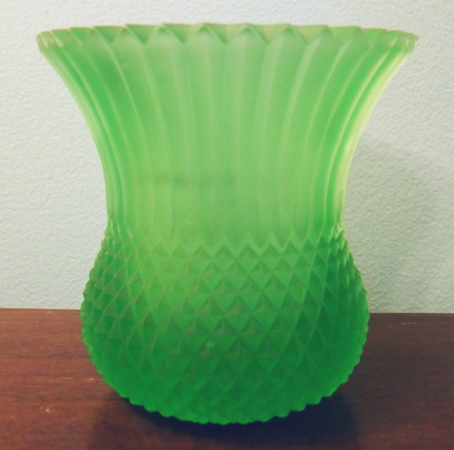 """Bright green FAROY candle cup, pattern similar to """"SAWTOOTH""""."""