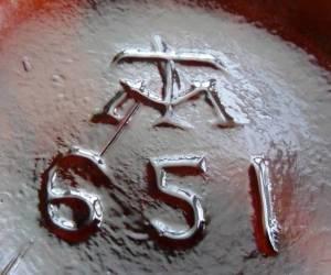 """Modes-Turner """"TM"""" monogram (on base of Hoster, Columbus, Ohio beer bottle)"""