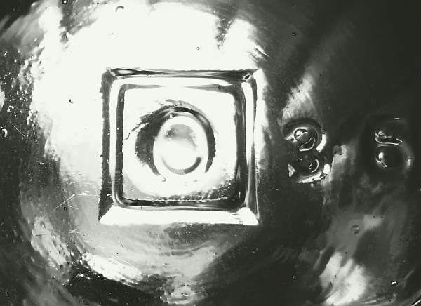 """O in a Square"" mark as seen on the base of a 1920s ketchup bottle."
