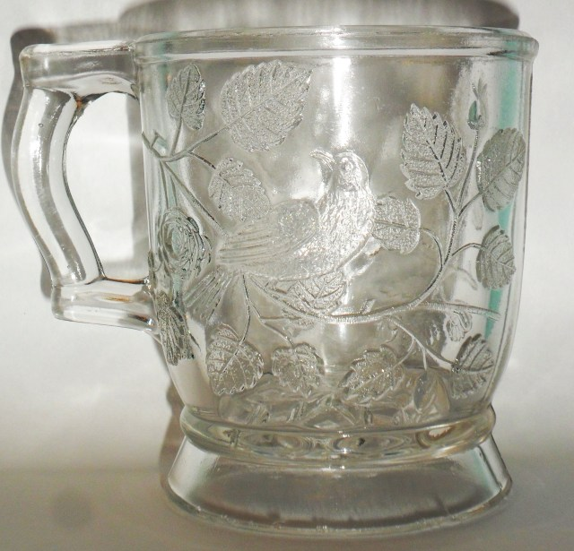 """Bryce Bros or U.S. Glass version of """"Robin in a Tree"""" mug in clear, circa 1880s/1890s."""