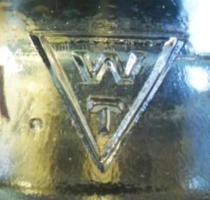 Whitall Tatum Company logo: W over T inside inverted triangle