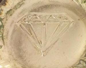 Cut diamond or some other type of jewel mark. on shot glass. (Photo courtesy of Patti Moreno.)