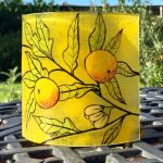 Fused glass free-standing hand-painted panel of oranges on foliage