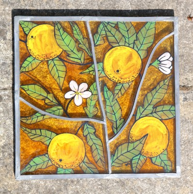 Handpainted, fused glass leaded panel of oranges