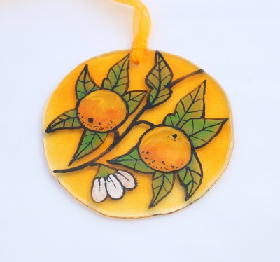 Handpainted oranges and foliage on fused glass circle