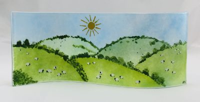 Long wavy fused glass hills with sheep