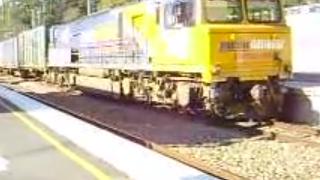 PN Freight train moves slowly through Glasshouse Mountains Railway Station