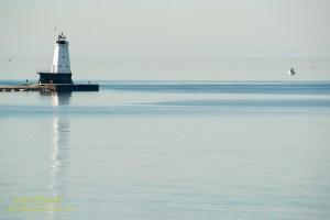 Fishing by the Ludington Lighthouse. By Joe Clark.