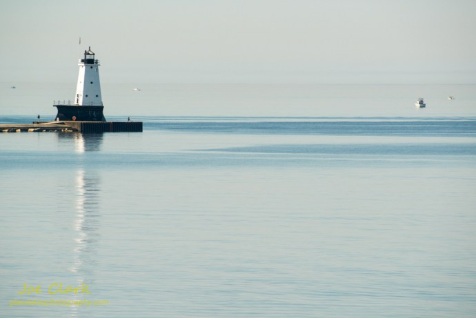 Fishing by the Ludington Lighthouse. By Joe Clark.