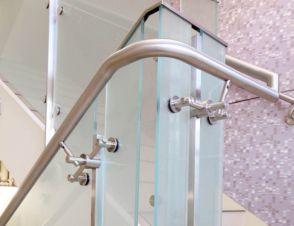 "The 1.5"" stainless steel handrail is skillfully bent to achieve a fluid aesthetic around corners and other radius designs."