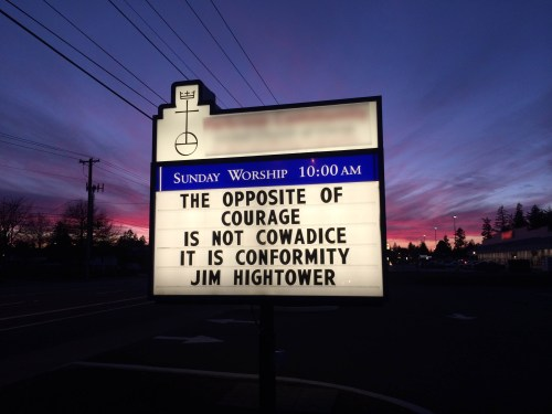 "A church sign with the word coward misspelled. (Missing an ""r"".)"