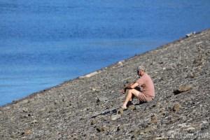 Photo: Man contemplating at reservoir