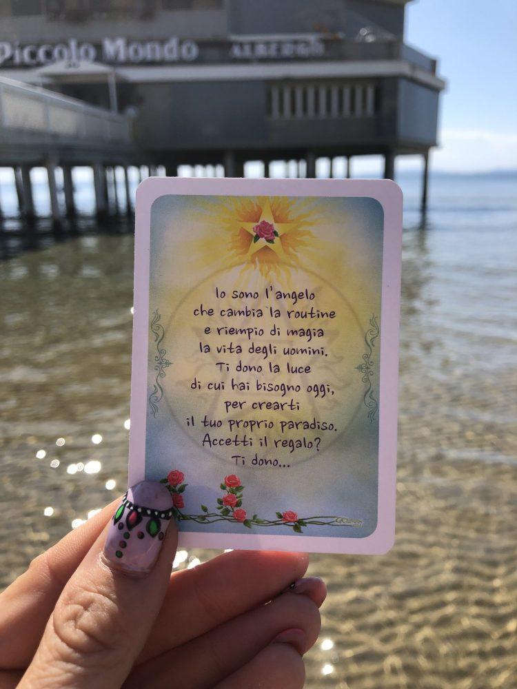 carte degli angeli in spiaggia