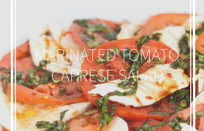 white plate of sliced tomatoes and mozzarella cheese with chopped basil and balsamic glaze on top