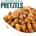 a white bowl of garlic parmesan pretzel nuggets with parmesan sprinkled on top