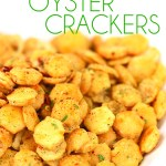 a bowl of spicy ranch oyster crackers with title