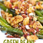 a close up shot of green beans topped with bacon, blue cheese, and walnuts