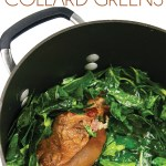 a pot of cooked collard greens with a cooked ham hock