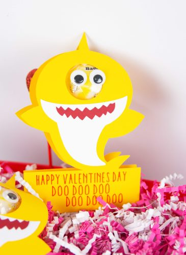 baby shark valentine made with cricut with a sucker with pink and white confetti