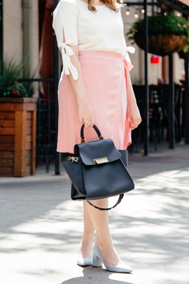 Navy satchel with a pink mini skirt