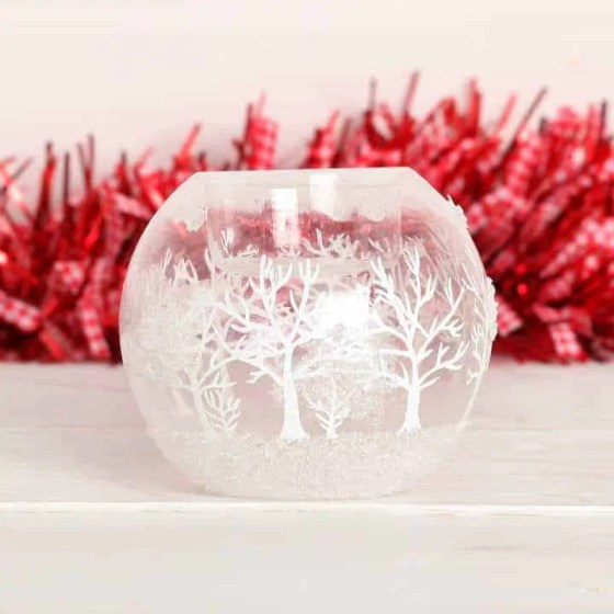 the best winter candles to give your home a cosy feel red berry apple frosted winter tree candle holder