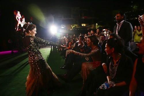 Madhuri gets off the stage to greet fellow celebrities