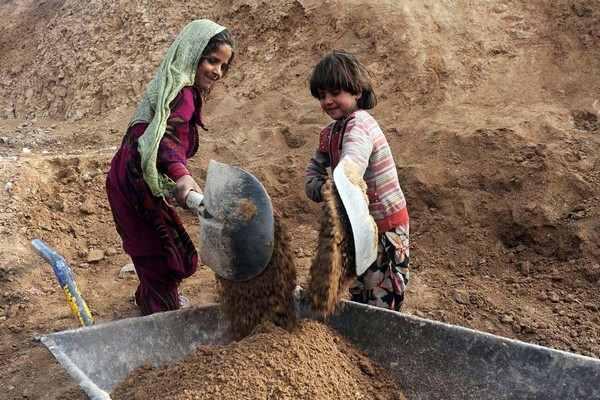 Afghan children work