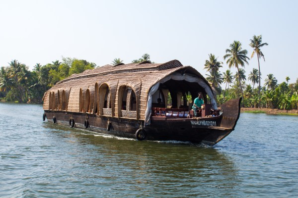 Splashing out on a house boat to cruise the beautiful backwaters of Kerala is worth the extra expense