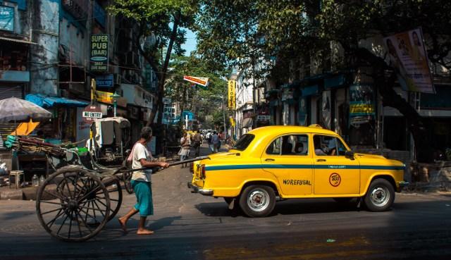 hand rickshaw and yellow cab calcutta kolkata