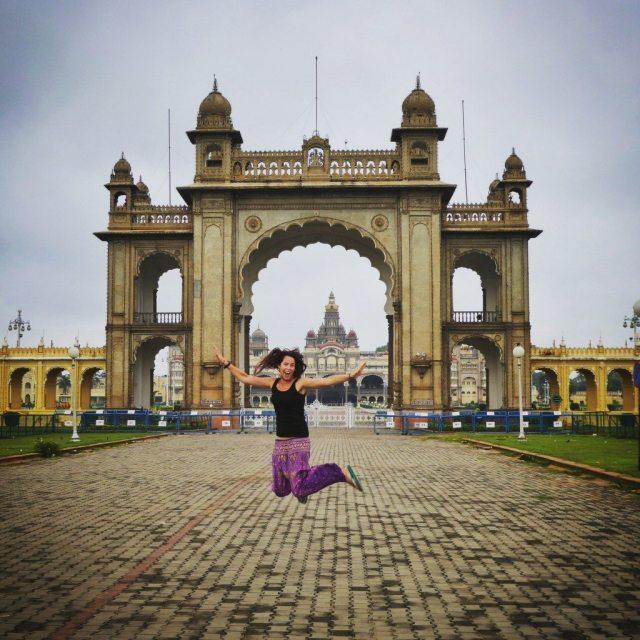 backpacking India jumping outside the elaborate Mysore Palace