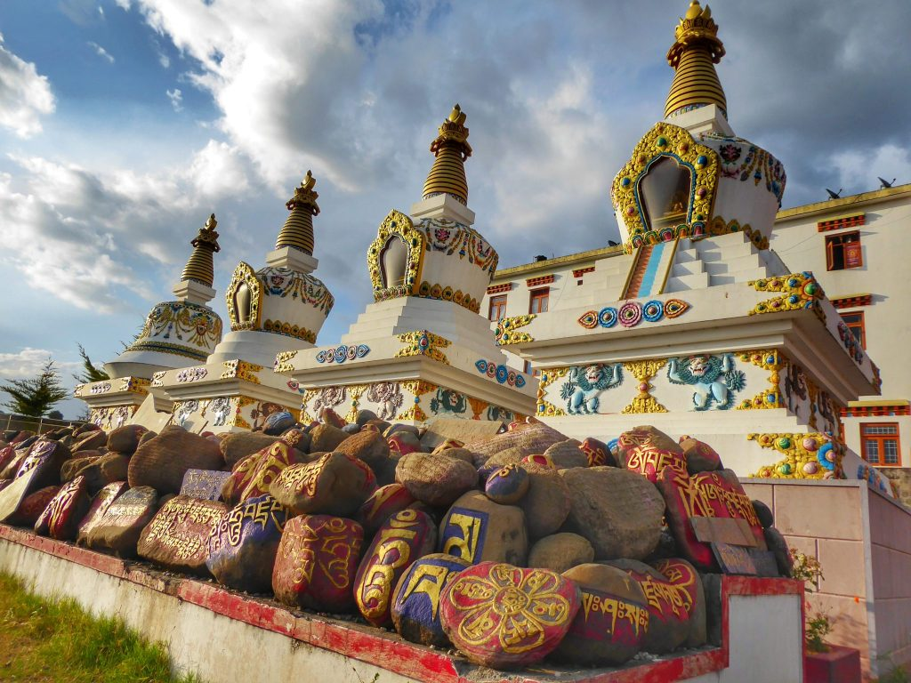 I love how these stones are painted and the Tibetan writing coloured in gold underneath these imposing stupas at Chouckling Monastery