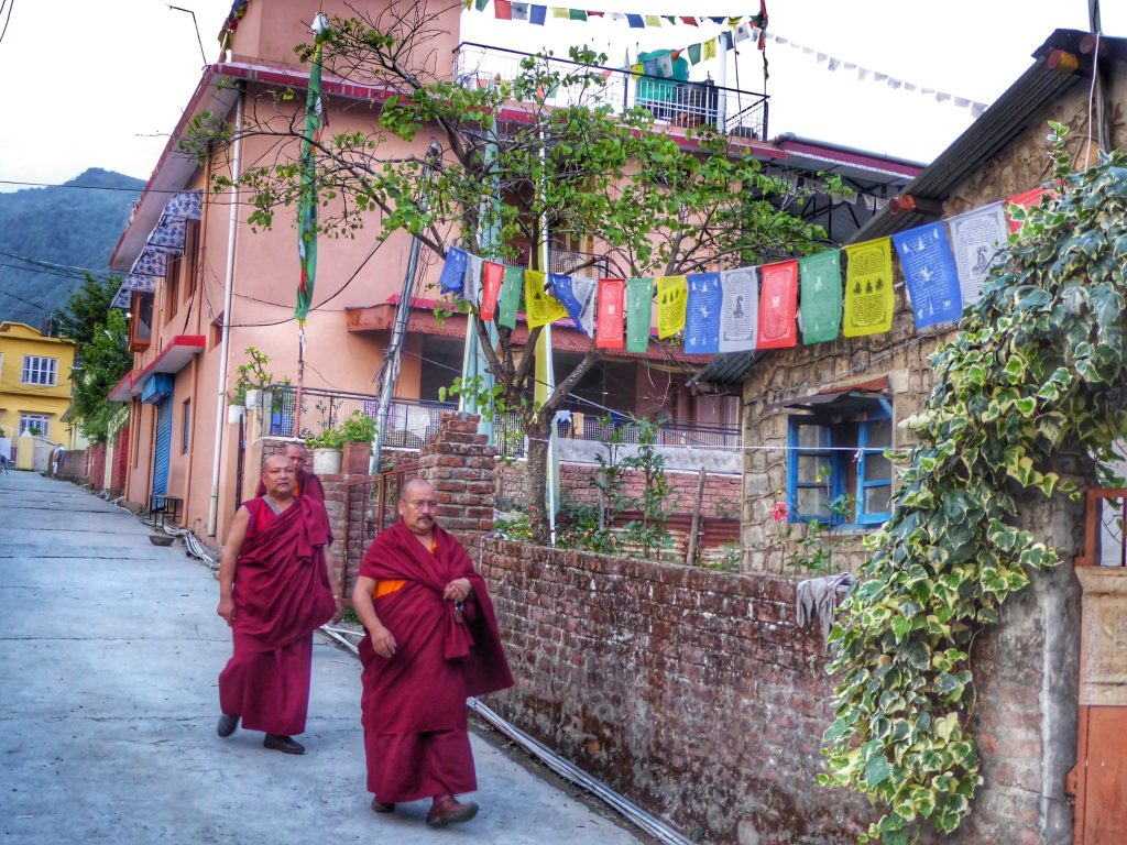 Monks walking through the Tibetan Colony in Bir