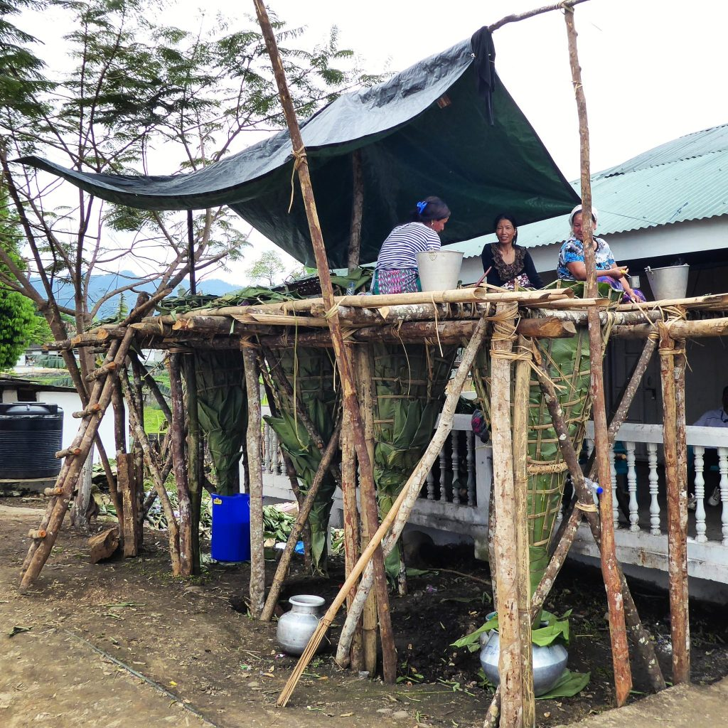 Making Apong - rice wine at the Mopin festival in Aalo, Arunachal Pradesh