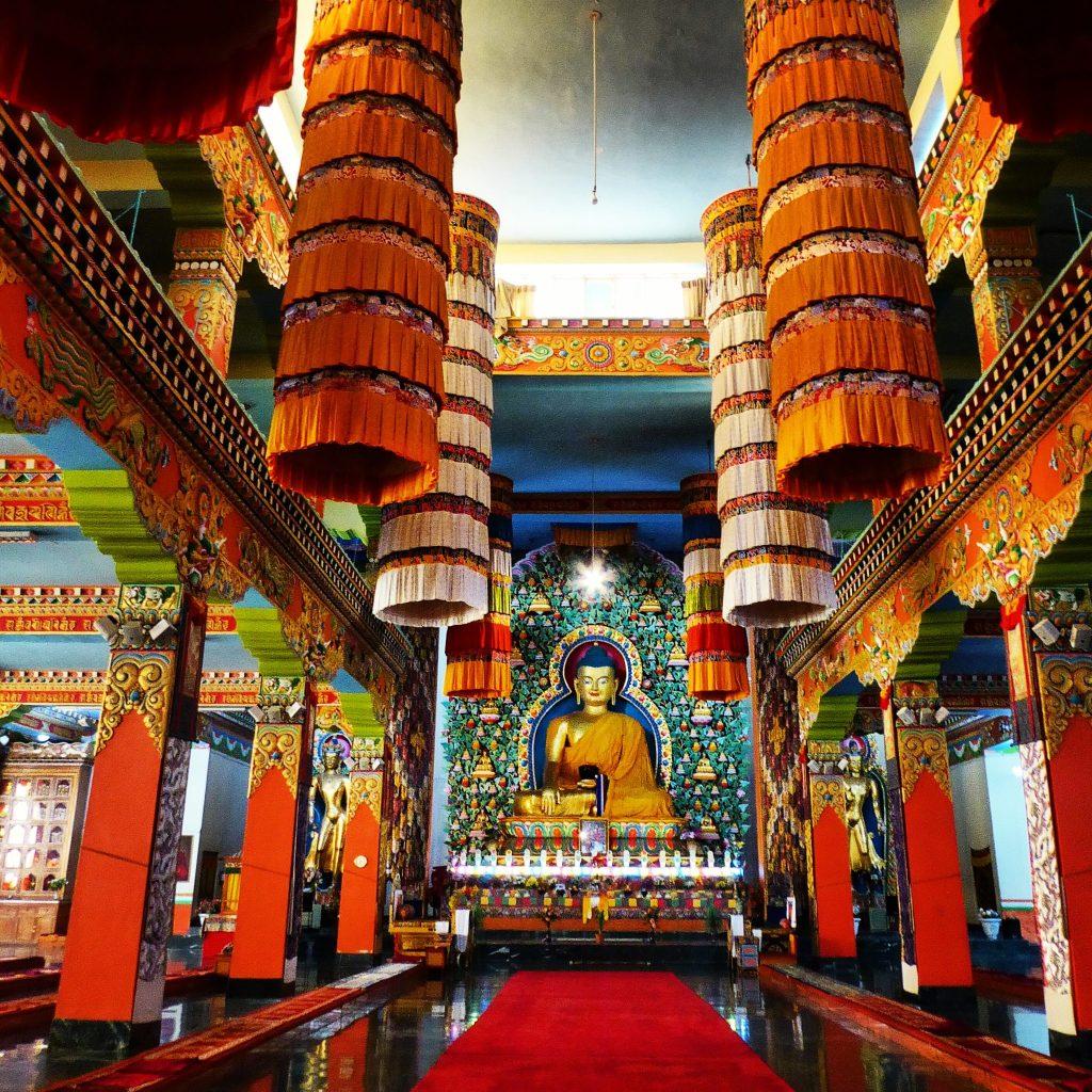 Inside the Dzongsar Khyentse Chökyi Lödrö College in the huge, beautiful modern gompa.