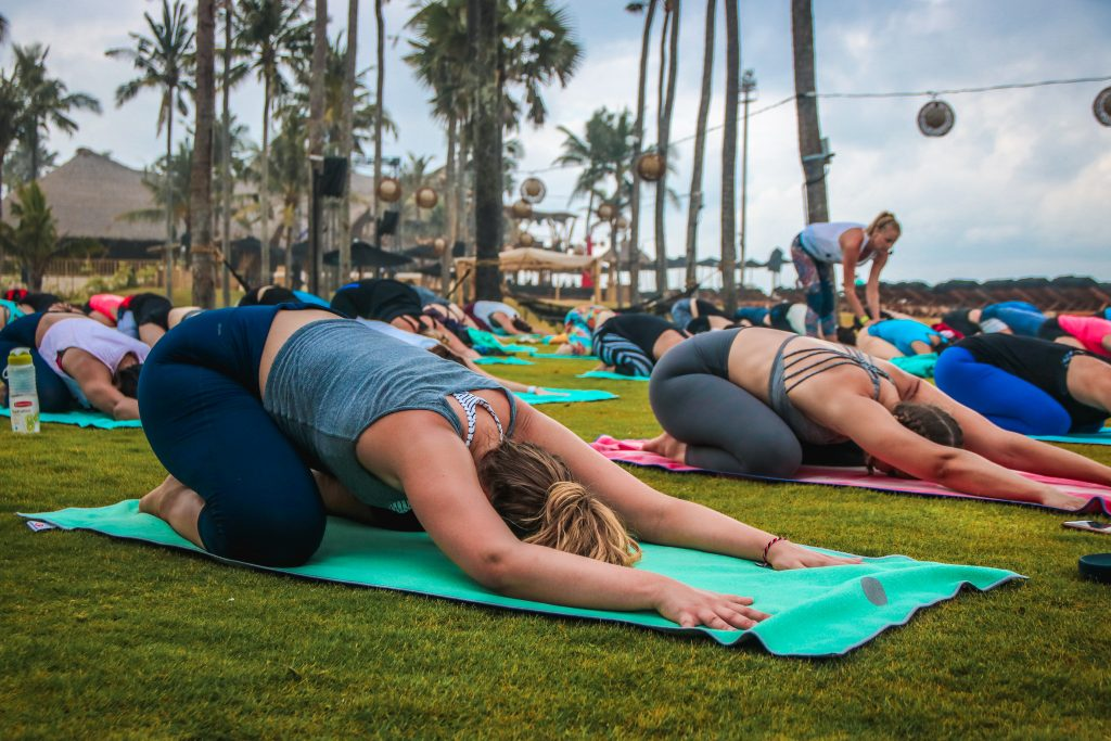 Outdoor yoga class. Photo credit: Knmata (Shutterstock)