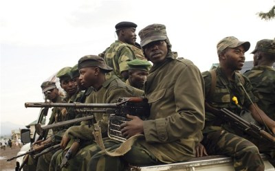 Rebel soldiers were driving and marching out of Goma to return to positions they held before they took the city . Photo Credit: AFP/GETTY