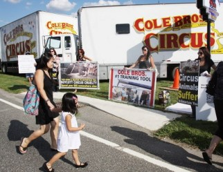 Circus-goers walk by protesters on their way to the Cole Bros. Circus. Photo Credit: Calista Condo, Gloucester County Times