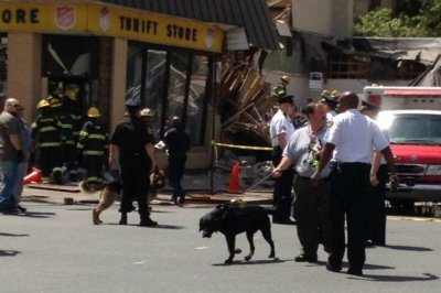 K-9 units were among the first to enter the collapsed building in Philadelphia to search for victims. Photo credit: Les Carpenter, Yahoo Sports